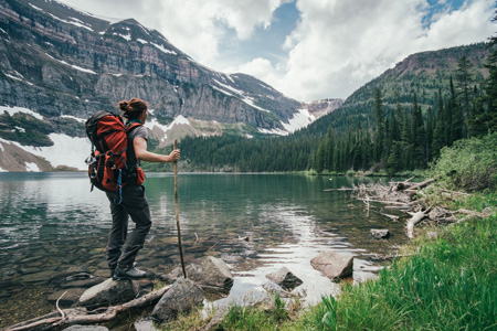 student hiking in mountains